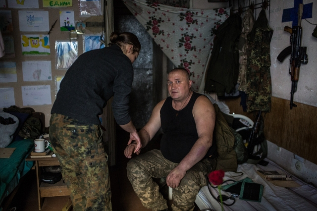A soldier is being treated by nurse Masha.